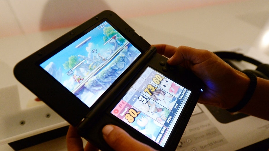 File photo: An attendee plays the Super Smash Bros game for Nintendo 3DS at the 2014 Electronic Entertainment Expo, known as E3, in Los Angeles, California June 11, 2014.REUTERS/Kevork Djansezian