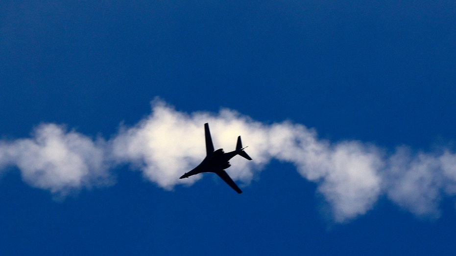 File photo - A USAF B-1 bomber aircraft flies over the Syrian town of Kobani, as seen from the Mursitpinar crossing on the Turkish-Syrian border in Sanliurfa province, following an airstrike on Nov. 9, 2014. (REUTERS/Yannis Behrakis)