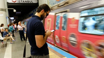 A passenger uses his smartphone as he waits for the train at a subway station in Istanbul, Turkey, June 14, 2017. REUTERS/Murad Sezer - RTS171LU