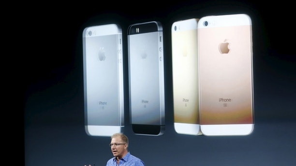 Apple Vice President Greg Joswiak introduces the iPhone SE during an event at the Apple headquarters in Cupertino, California, March 21, 2016. REUTERS/Stephen Lam/File Photo - RTX2BV86