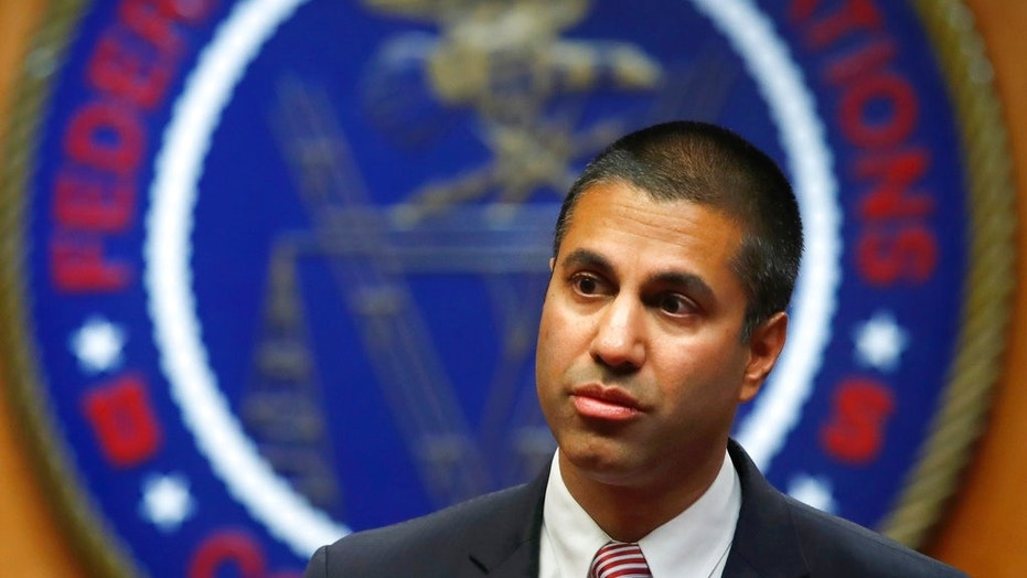 FILE - In this Dec. 14, 2017 record photo, Federal Communications Commission (FCC) Chairman Ajit Pai is shown nearing for an FCC meeting. (AP Photo/Jacquelyn Martin, File)  (Copyright 2017 The Associated Press. All rights reserved.)