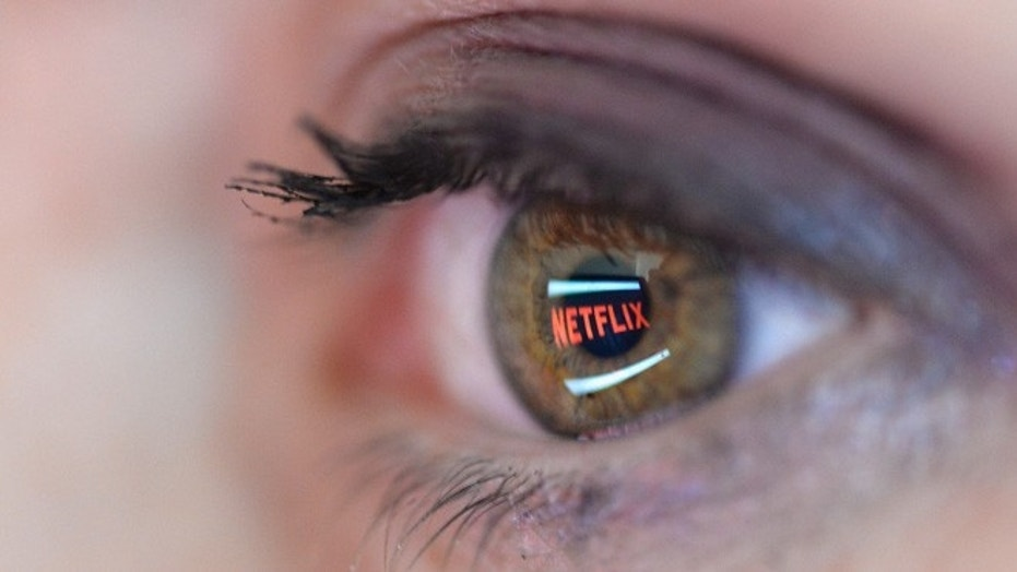 File photo: In this photo illustration, the Netflix logo is reflected in the eye of a woman on September 19, 2014 in Paris, France. (Photo by Pascal Le Segretain/Getty Images)  (2014 Getty Images)