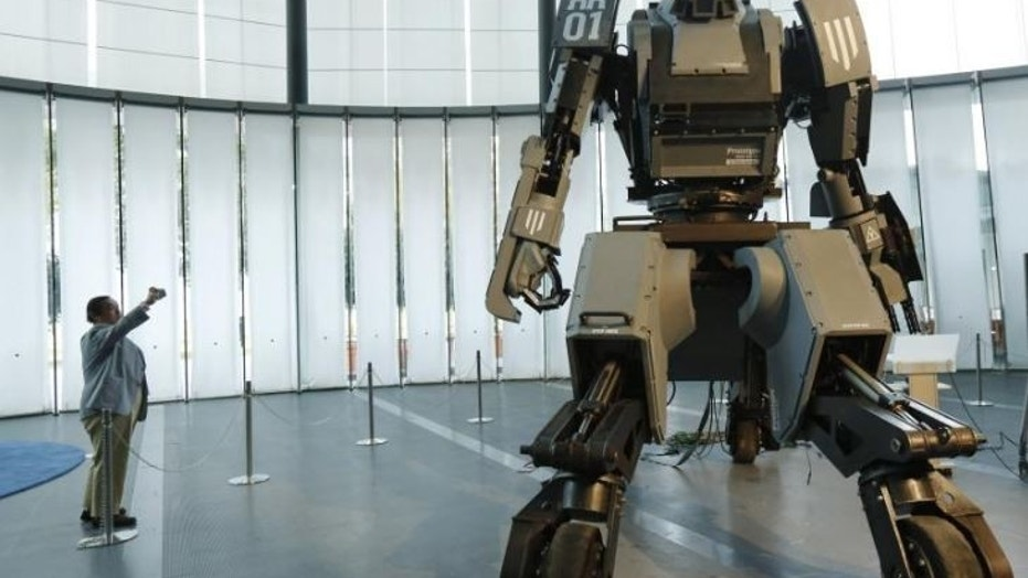 "The ""Kuratas"" military robot in Tokyo, seen above, can be controlled by a pilot or via a smartphone. It is armed with a futuristic weapons system."