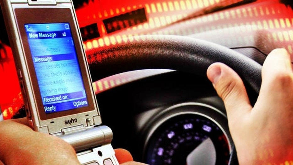 Several states are experimenting with adding jail-time for distracted drivers. (Credit: AP)