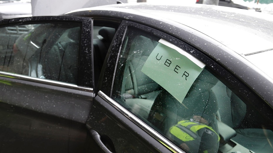 FILE: An Uber driver has been suspended after recording hundreds of riders without their permission and streamed the live video online, a report said.