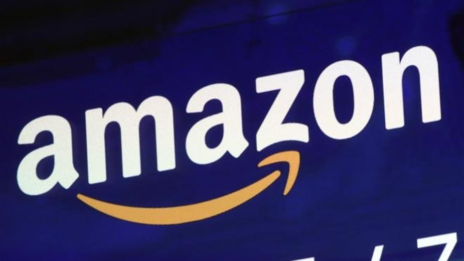 The logo for Amazon is displayed on a screen at the Nasdaq MarketSite, Friday, July 27, 2018.