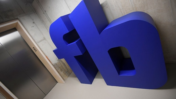 A giant logo is seen at Facebook's headquarters in London, Britain, December 4, 2017. REUTERS/Toby Melville - RC140919E620