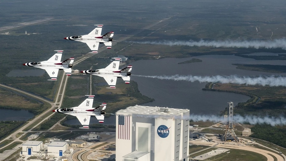 President Donald Trump wants a new Space Force branch of the U.S. military, but it reopens an old argument about military uses in space. Here, the U.S. Air Force Thunderbirds fly over NASA's Kennedy Space Center in Florida with retired NASA astronaut and Air Force Col. Buzz Aldrin. Credit: U.S. Air Force photo/Tech. Sgt. Christopher Boitz