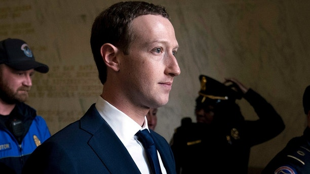 FILE - In this April 11, 2018, file photo, Facebook CEO Mark Zuckerberg departs after testifying before a House Energy and Commerce hearing on Capitol Hill in Washington about the use of Facebook data to target American voters in the 2016 election and data privacy. The New York Times says Facebook has acknowledged it shared user data with several Chinese handset manufacturers, including Huawei, a company flagged by U.S. intelligence officials as a national security threat. The report says Facebook said Tuesday, June 5, the handset makers including Huawei, Lenovo, Oppo and TCL were among 60 it had shared data with as early as 2007. Facebook told the newspaper it planned to wind down the Huawei deal this week. (AP Photo/Andrew Harnik, File)