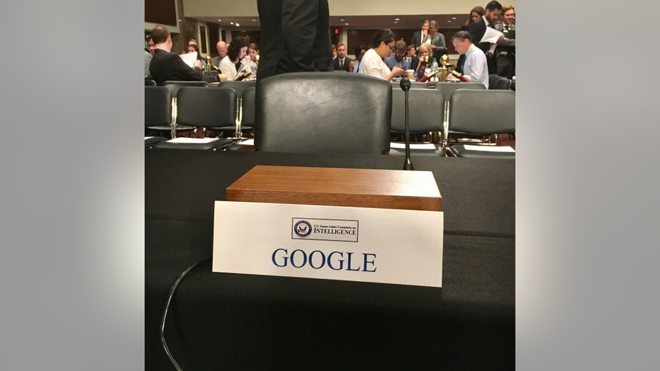 The empty chair at Wednesday's Senate Intelligence Committee hearing (Sen. Mark Warner, via Twitter)