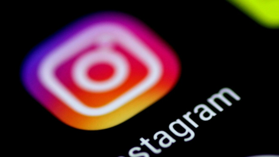 The Instagram application is seen on a phone screen August 3, 2017. REUTERS/Thomas White - RC1D00BE0000