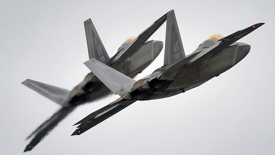 File photo - Two F-22 Raptor fighter jets from the 3rd Wing at Joint Base Elmendorf-Richardson, Alaska, conduct approach training, in this U.S. Air Force picture taken March 24, 2016. (REUTERS/U.S. Air Force/Justin Connaher/Handout via Reuters)