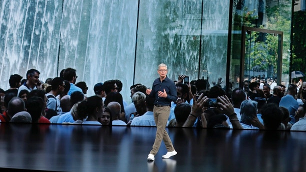 Apple CEO Tim Cook speaks at the Steve Jobs Theater during an event to announce new Apple products Wednesday, Sept. 12, 2018, in Cupertino, Calif. (AP Photo/Marcio Jose Sanchez)