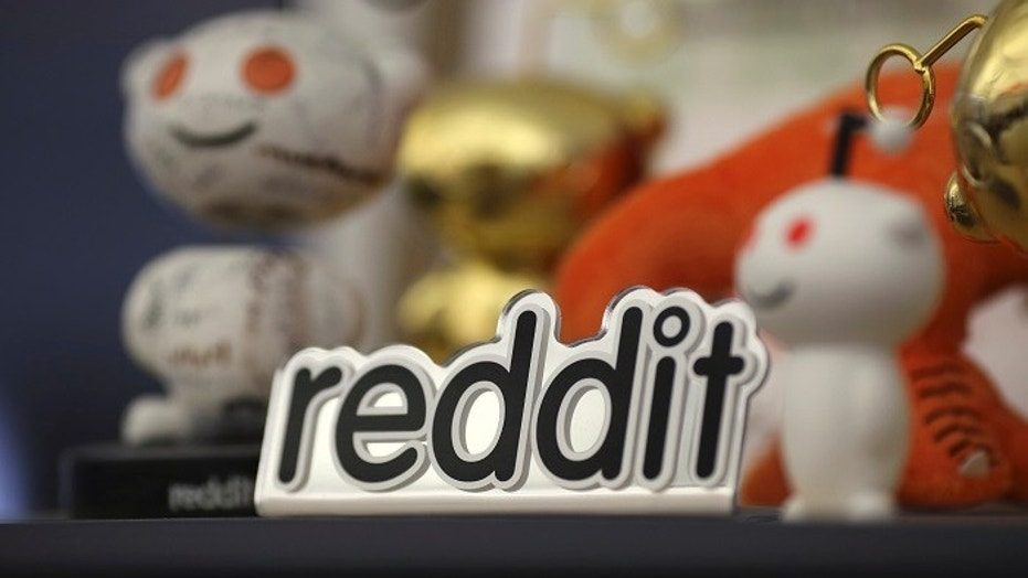 "File photo: Several Reddit communities devoted to QAnon, a collection of radical ""deep state"" conspiracy theories, were banned from the site Wednesday. (Credit: REUTERS/Robert Galbraith)"