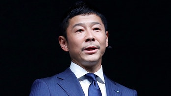 Yusaku Maezawa, the chief executive of Zozo, which operates Japan's popular fashion shopping site Zozotown and is officially called Start Today Co, speaks at an event launching the debut of its formal apparel items, in Tokyo, Japan, July 3, 2018. REUTERS/Kim Kyung-Hoon - RC1D3717BCE0
