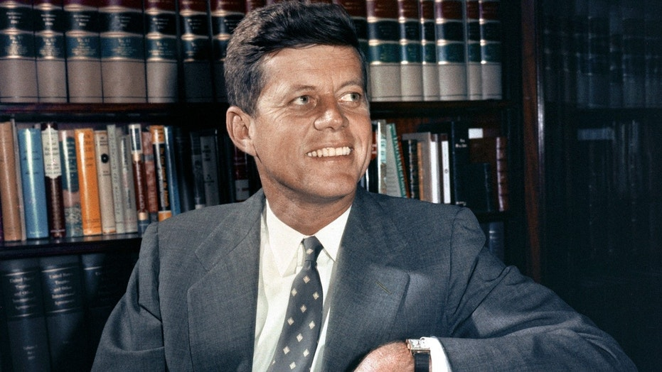 In this Feb. 27, 1959 file photo, Sen. John F. Kennedy, D-Mass., is shown in his office in Washington. (AP Photo, File)