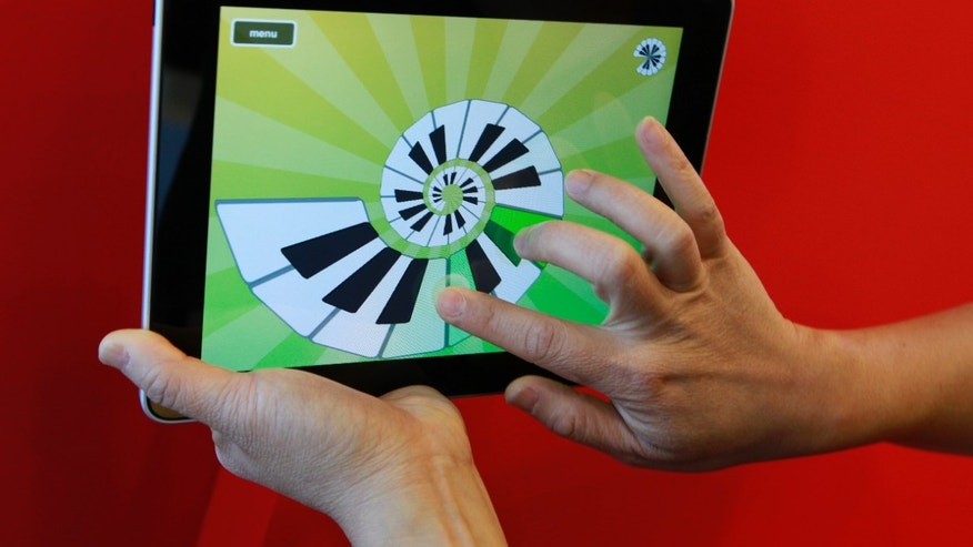 The Magic Piano iPad application is demonstrated in Palo Alto, Calif., Wednesday, April 7, 2010. (AP Photo/Paul Sakuma)
