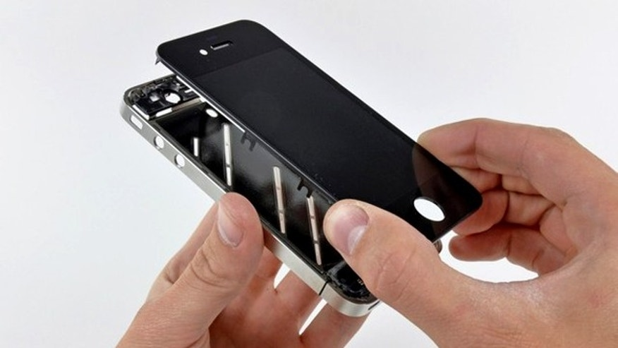 The front panel is removed from the iPhone 4 during iFixit's teardown of the phone in San Luis Obispo, California June 22, 2010. Apple Inc's hot-selling next-generation iPhone sports chips from Samsung Electronics, Micron Technology and STMicroelectronics, according to an early teardown, or disassembly analysis by technology firm iFixit. The well-reviewed iPhone 4 goes on sale on Thursday in five of the world's biggest economies -- China and its guarded telecoms sector being a notable exception -- and consumers hoping to score the device are expected to throng stores.   REUTERS/iFixit/Handout (UNITED STATES - Tags: SCI TECH BUSINESS) FOR EDITORIAL USE ONLY. NOT FOR SALE FOR MARKETING OR ADVERTISING CAMPAIGNS. MANDATORY CREDIT