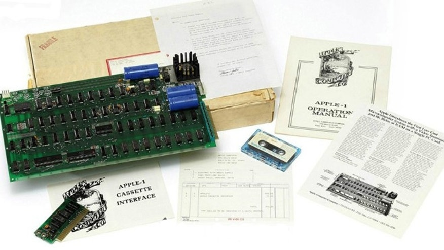 An An Apple-1 motherboard, number 82, printed label to reverse, with a few slightly later additions -- sold at Christie's auction house for over $200,000 in 2010.