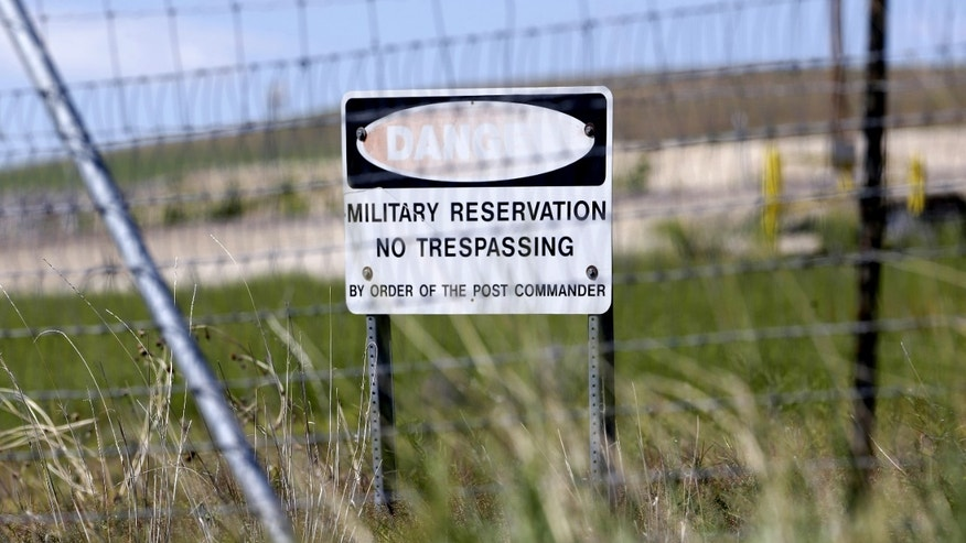 June 7, 2013: A military no trespassing sign shown in front of Utah's NSA Data Center in Bluffdale, Utah.  The nation's new billion-dollar epicenter for fighting global cyberthreats sits just south of Salt Lake City, tucked away on a National Guard base at the foot of snow-capped mountains. The long, squat buildings span 1.5 million square feet, and are filled with super-powered computers designed to store massive amounts of information gathered secretly from phone calls and emails.