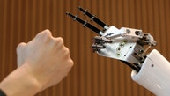 """Japan's Nippon Engineering College's humanoid robot """"Karfe Lady"""" and a man play a game of """"rock-paper-scissors"""" during a robot sports event in Tokyo's Akihabara electronic district October 20, 2007.     REUTERS/Toru Hanai (JAPAN) - RTR1V43X"""