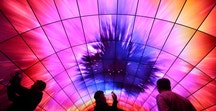 Attendees view video on a tunnel of LG OLED televisions during the 2017 CES in Las Vegas, Nevada, U.S., January 5, 2017. REUTERS/Steve Marcus - RTX2XOOX