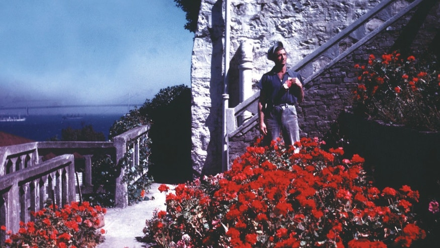 This photo released by the Garden Conservancy shows a prisoner in the gardens along Officers' Row on Alcatraz, ca 1934-46.