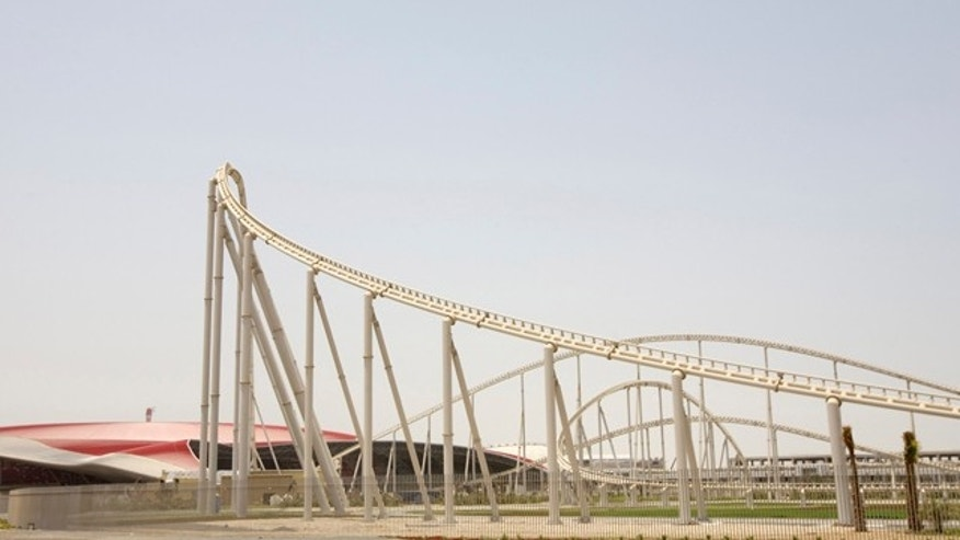 In this photo taken on Aug. 10, 2010, a roller coaster track is seen at The Ferrari World Abu Dhabi Theme Park in Yas Island in Abu Dhabi, United Arab Emirates. The Italian automaker plans to rev up an arena more known for cartoon characters and superheroes when Ferrari World opens Wednesday with what the company says is the world's fastest roller coaster and a 20-story tower ride that duplicates the G-forces felt by race car drivers.  (AP Photo/Nousha Salimi)