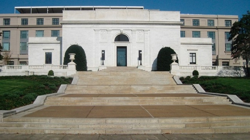 The American Pharmaceutical Association is seen in Washington in this photo taken Nov. 4, 2009. The capital is a city of magnificent front entrances that people can't enter. On Constitution Avenue, Pennsylvania Avenue and Capitol Hill, sweeping marble staircases, sculptures, manicured gardens and ornate doors beckoned citizens of the past. Now most stand empty and sealed, a forbidden welcome.  (AP Photo/Cal Woodward)
