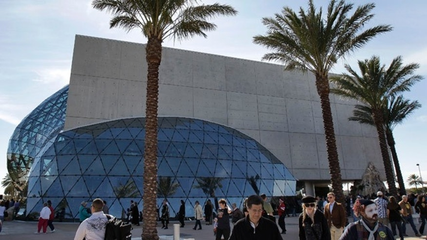Visitors walk outside the new Salvador Dali museum after grand opening ceremonies in St. Petersburg, Fla., Tuesday, Jan. 11, 2011. (AP Photo/Chris O'Meara)