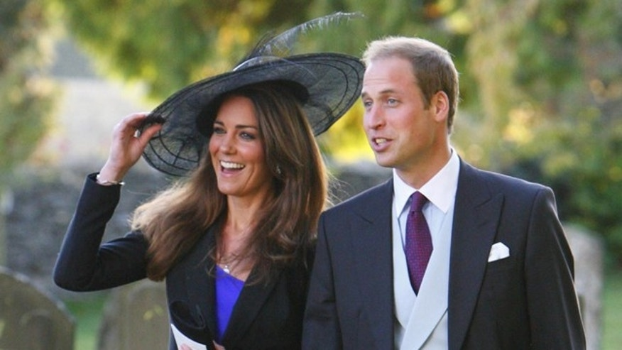 FILE --  Britain's  Prince William and Kate Middleton leave the wedding of their friends Harry Mead and Rosie Bradford in the village of Northleach, England, in this October 23, 2010, file photo. (AP Photo/Chris Ison, pa , file)