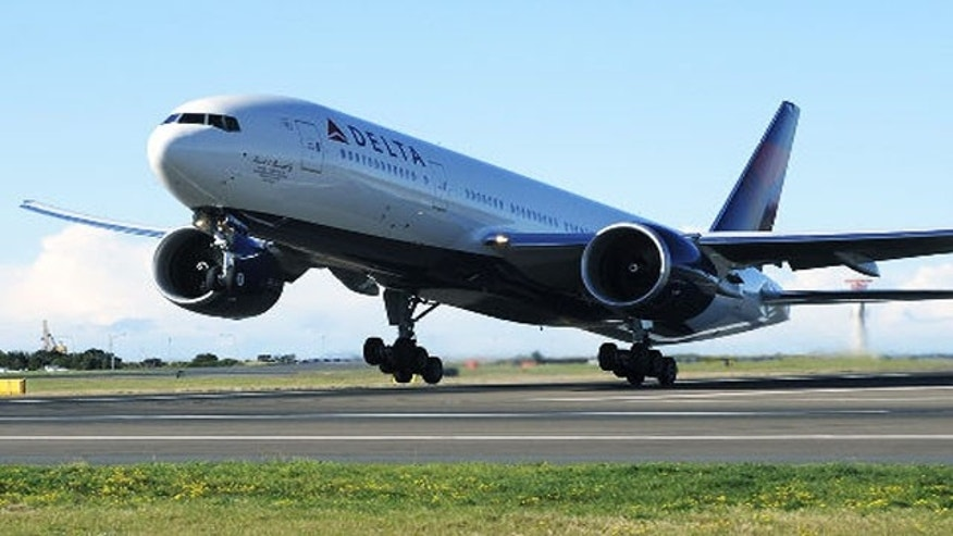 FILE: A Delta Airlines plane takes off on its inaugural Sydney to Los Angeles flight from Sydney International Airport.