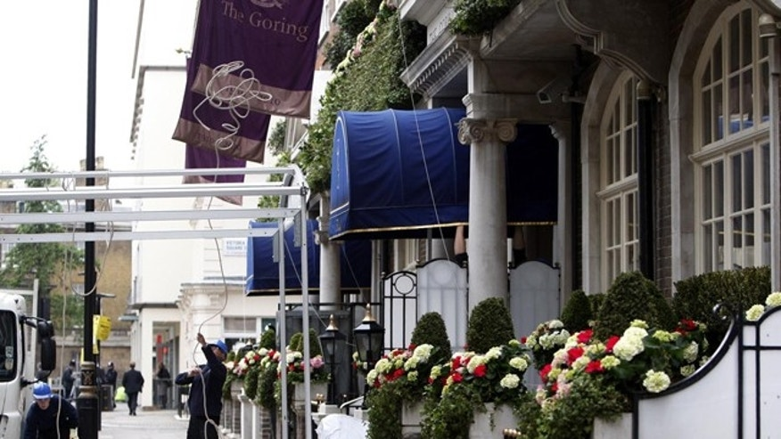 Workers erect a screen outside the entrance to London's Goring Hotel Thursday April 28, 2011. Kate Middleton's spending her last night as a single woman in a room fit for a queen. The princess-in-waiting is staying Thursday night at London's Goring Hotel, a family run luxury hotel just around the corner from Buckingham Palace. (AP Photo/Sean Dempsey, PA)  UNITED KINGDOM OUT
