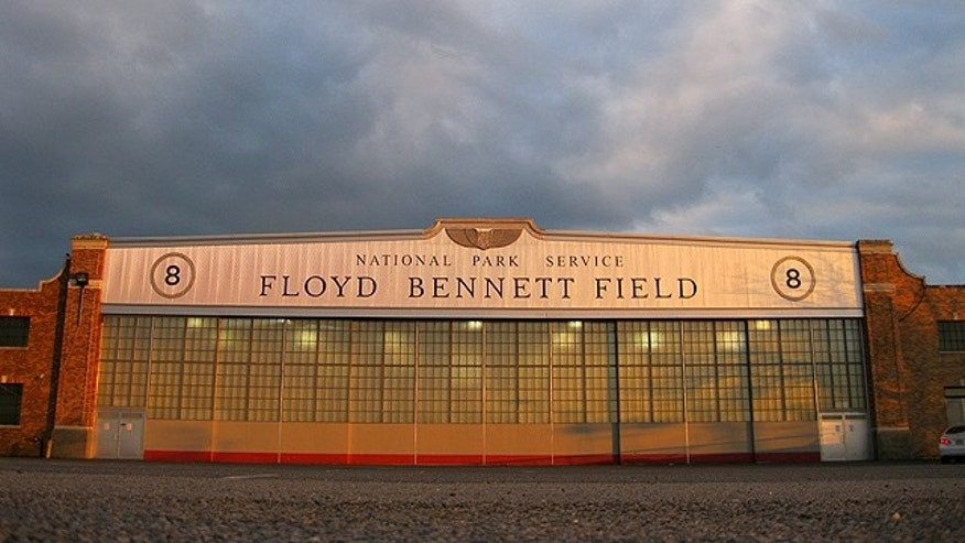 In this March 11, 2011 photo, a National Park Service hangar emblazoned with the name Floyd Bennett Field glows orange at sunset at New York Citys ghost airport in Brooklyn, N.Y.  The city is struggling to find space to expand its overloaded airports, but Floyd Bennett Field cant be reactivated permanently because the old airport belongs to the National Park Service. (AP Photo/Chris Hawley)
