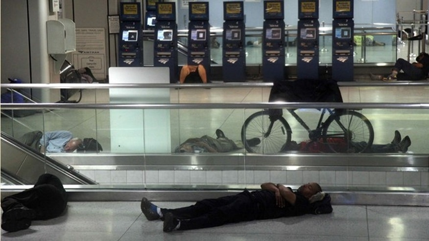 People sleep at Penn Station in New York, early Sunday, Aug. 28, 2011, as Hurricane Irene approaches the region. Public transportation in New York shut down around noon on Saturday. Irene has the potential to cause billions of dollars in damage all along a densely populated arc that includes Washington, Baltimore, Philadelphia, New York, Boston and beyond. At least 65 million people could be affected. (AP Photo/Chelsea Matiash)