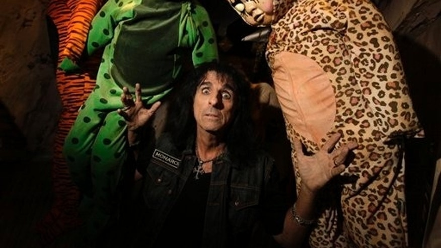 Rocker Alice Cooper poses at Universal Studios Hollywood's annual Halloween Horror Nights attraction in Los Angeles.