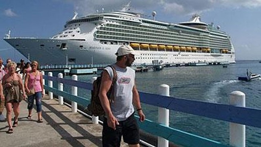 Cruise line passengers disembark for a shore visit.