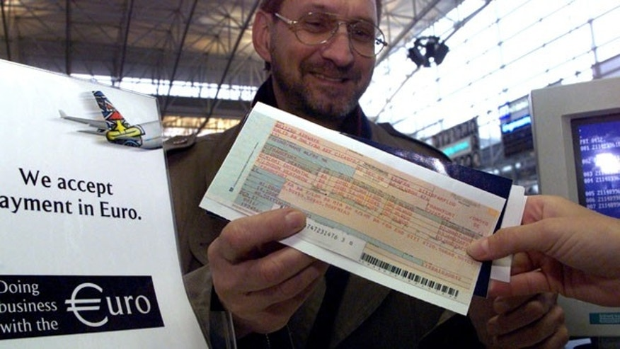 Ludwig Hamburger, a passenger on British Airways, purchases the first airline ticket sold by the British airline in the new single currency at Frankfurt's Rhine-Main-Airport early January 1. The euro was born on January 1 and Frankfurt, home to the European Central Bank, is planning a weekend of festivities to mark the occasion. ??»