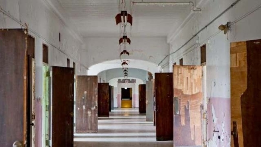 Dec. 16, 2011: A hallway at the Trans-Allegheny Lunatic Asylum in Weston, W. Va. The former psychiatric hospital is now being marketed as a historic and paranormal tourist attraction.