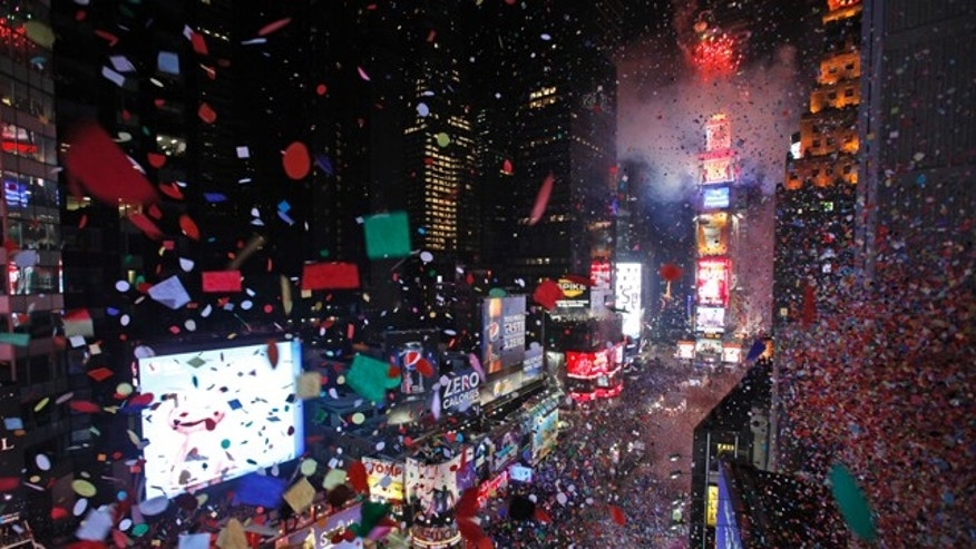 Confetti is seen flying over New York's Times Square from the balcony of the Marriott Marquis hotel when the clock struck midnight during the New Year's Eve celebration,   Friday, Dec. 31, 2010.  (AP Photo/Mary Altaffer)