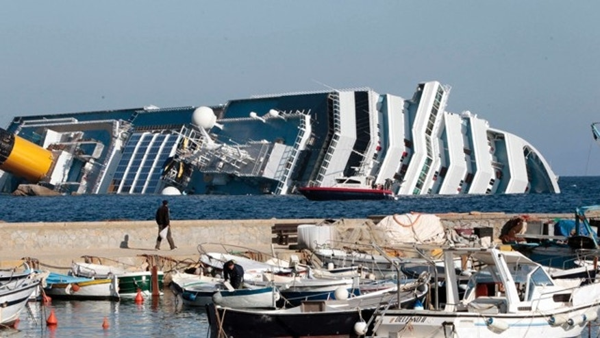 Jan. 14, 2012: The luxury cruise ship Costa Concordia leans on its starboard side as seen from the Giglio harbor, after running aground off the tiny Tuscan island of Giglio, Italy. The luxury cruise ship ran aground off the coast of Tuscany, sending water pouring in through a 160-foot (50-meter) gash in the hull and forcing the evacuation of some 4,200 people from the listing vessel early Saturday, the Italian coast guard said.  The number of dead and injured is not yet confirmed Coast Guard Cmdr. Francesco Paolillo said. (AP Photo/Gregorio Borgia)