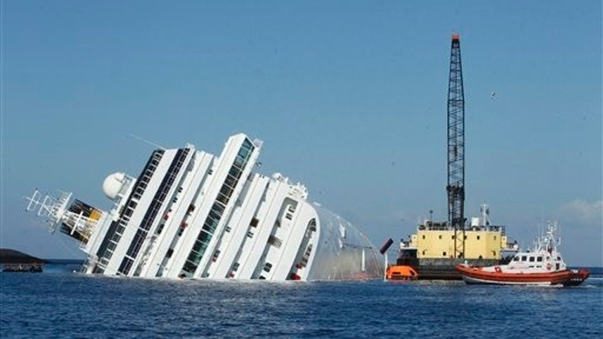 Jan. 24: A sea platform carrying a crane approaches the grounded cruise ship Costa Concordia off the Tuscan island of Giglio, Italy.