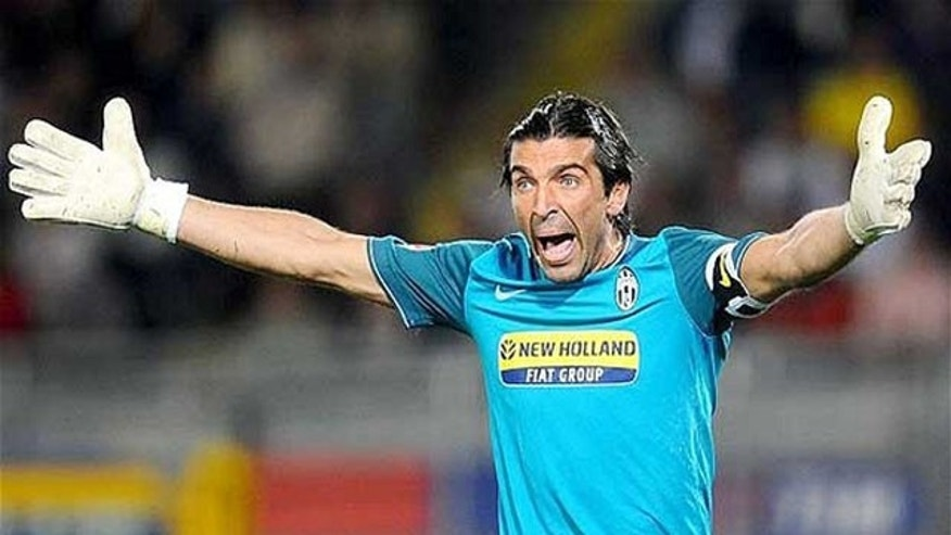 Goalkeeper, Gianluigi Buffon, reacts at  the Italian Serie A soccer match between Juventus and Livorno,  at the Olympic Stadium in Turin, Italy, Saturday, Sept. 19, 2009.
