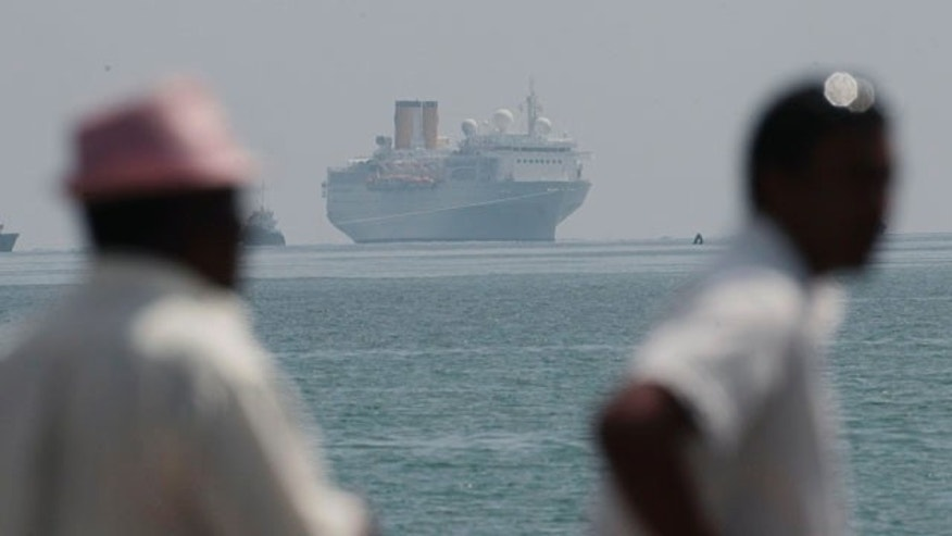 The Costa Allegra is towed in Victoria harbor, Seychelles Island, Thursday, March 1, 2012.