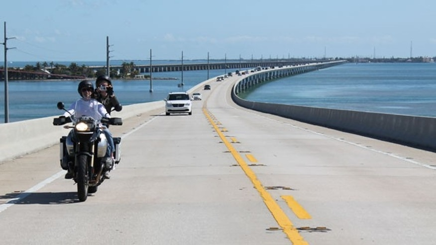 In this February 2012 photo motorcyclists ride on Seven Mile Bridge along the Overseas Highway, U.S. 1.