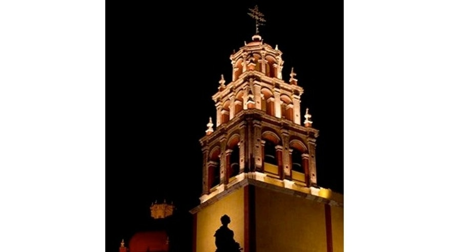 March 2, 2012: The Basilica Colegiata de Nuestra Señora de Guanajuato is lit at night in the colonial city of Guanajuato, Mexico.