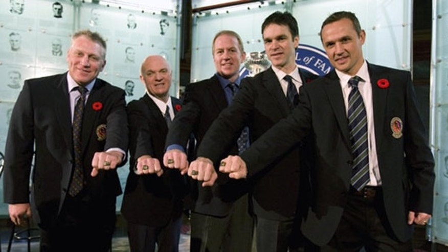 The  Hockey Hall of Fame documents the sport's captivating past. Hockey Hall of Fame inductees include (from left) Brett Hull, Lou Lamoriello, Brian Leetch, Luc Robitaille and Steve Yzerman.