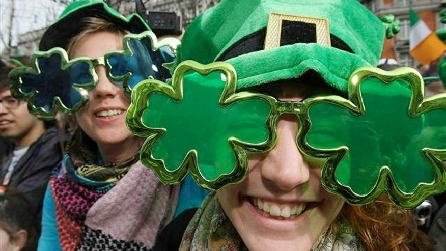 March 2010: People wearing shamrock glasses at the St Patrick's Day parade in Dublin, Ireland.