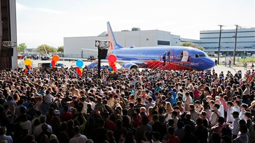March 21, 2012: Southwest Airlines employees get a first look at the Boeing 737-800 during a launch party in Dallas, Texas.