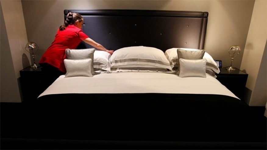 March, 16, 2012:  A maid adjusts the pillows in one of the five bedroom luxury penthouse apartments overlooking Hyde Park. The suite will go for US$17,600 a night during the London 2012 Olympics.